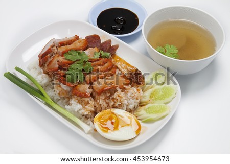 Barbecued red pork in sauce with rice, Chinese style roasted pork.