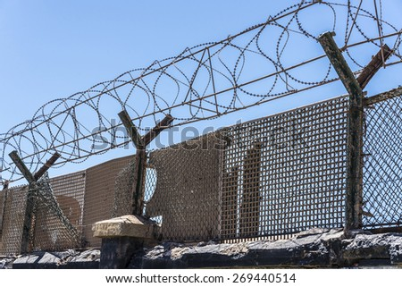 Barbed wire against the sky - stock photo