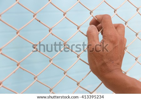 Barbed Wire and a hand