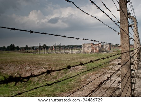 Barbed wire electrical fence at Auschwitz Birkenau , Poland - stock photo