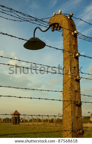 Barbed wire fence in Auschwitz II-Birkenau Concentration Camp in Poland near Krakow.