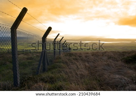 barbed wire fencing protecting a site on the Knockanore hill in Ballybunion county Kerry Ireland - stock photo