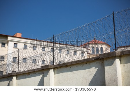 barbed wire in jail - stock photo