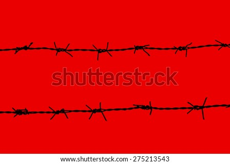 Barbed wire isolated on red background