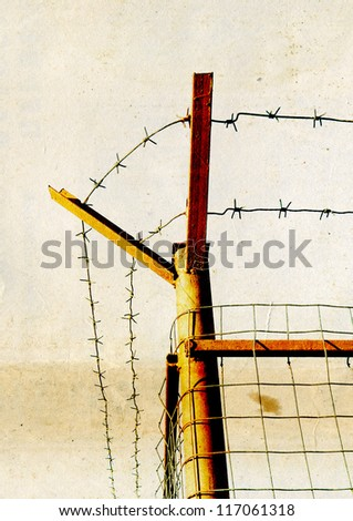 barbed wire on grunge background - stock photo