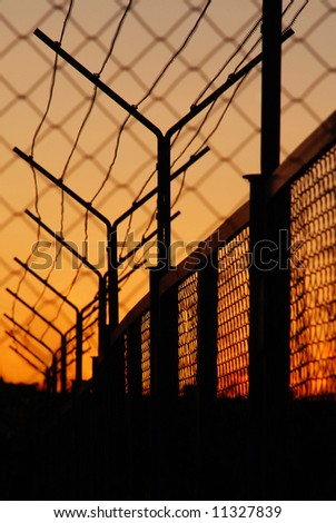 Barbed wire on sunset background - stock photo