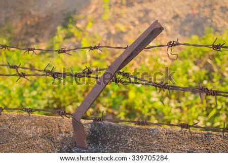 Barbed Wired fence closeup - stock photo