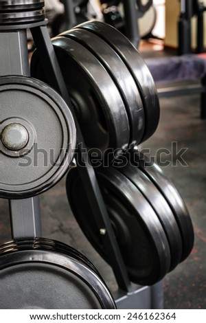 Barbell plates rack - stock photo