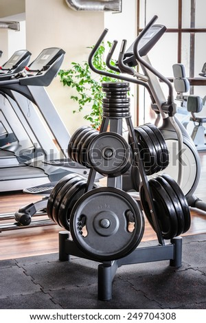 Barbell plates rack in the gym - stock photo