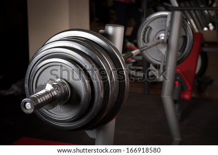 Barbell ready to workout, indooors, shallow DOF