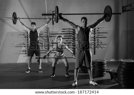 Barbell weight lifting group workout exercise at gym box - stock photo