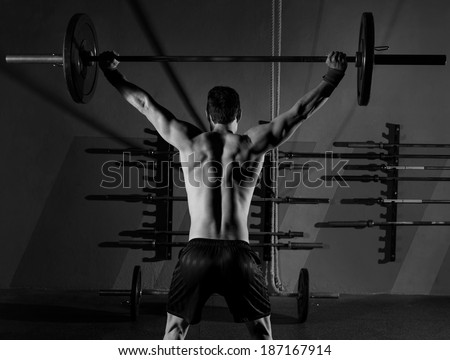 barbell weight lifting man rear view back workout exercise at gym box - stock photo
