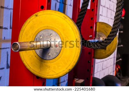 Barbells in a gym bar bells and rope at cross fit - stock photo
