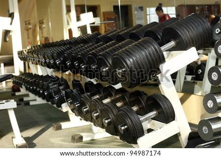 barbells in gym - stock photo