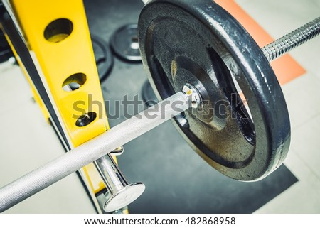 Barbells weight in gym room, Fitness equipment, Old dumbbell - Vintage filter process style