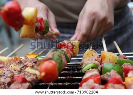 Barbeque Grill Street Food in thailand,Eat outdoors in a happy family.