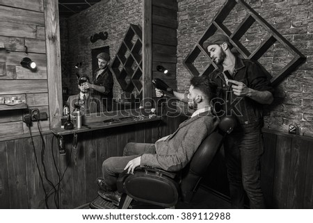 Barber combs client Barbershop