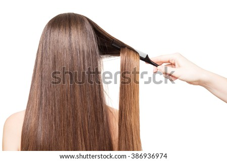 Barber combs Hand luxurious long hair isolated on white background. - stock photo