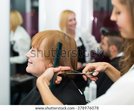 barber makes the cut for happy  mature woman