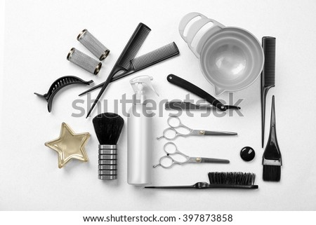 Barber set with tools, equipment and cosmetics on light background - stock photo