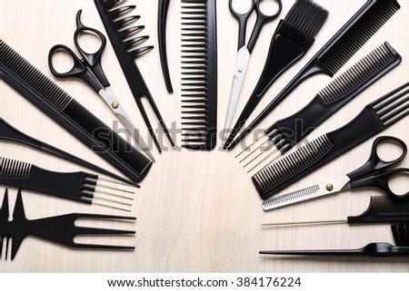 Barber set with tools on light wooden table