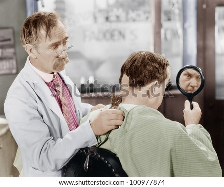 Barber shaving off too much hair - stock photo