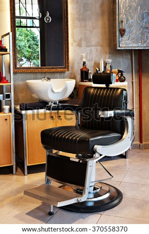 barber shop interior very stylish with a very stylish and vintage chair - stock photo