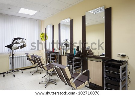 Barbershop room with three working places in the beauty salon - stock photo