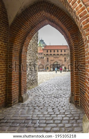 Barbican (built around 1498). Gate to Krakow - the best preserved barbican in Europe. Barbican fortress - one of the main landmarks of Krakow, formally connected with the historic city wall. Poland. - stock photo