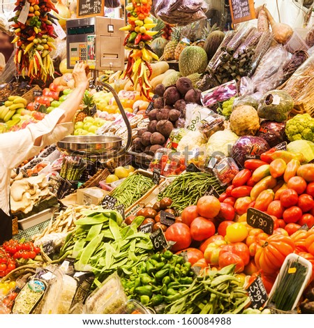 BARCELOLNA, SPAIN - OCTOBER 11: colorful market stand at the market La Boqueria on October 11, 2013 in Barcelona. La Boqueria is a famous market hall in Barcelona on about 2.600 square meters. - stock photo