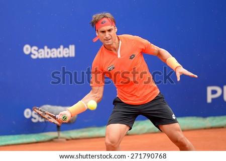 BARCELONA - APR 22: David Ferrer (Spanish tennis player) plays at the ATP Barcelona Open Banc Sabadell Conde de Godo tournament on April 22, 2015 in Barcelona, Spain. - stock photo