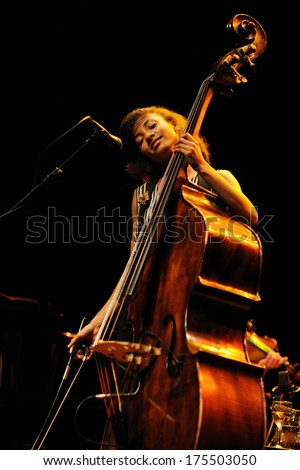 BARCELONA - APR 10: Esperanza Spalding (American jazz bassist, cellist and singer) performs at Auditori on April 10, 2011 in Barcelona, Spain. She has won a Grammy Awards defeating Justin Bieber. - stock photo