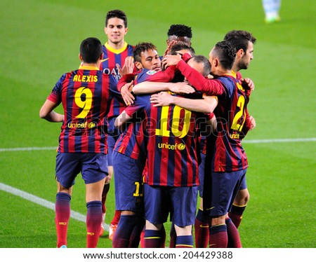 BARCELONA - APR 21: F.C. Barcelona footballers celebrate a goal against Athletic Bilbao at the Camp Nou Stadium on the Spanish League on April 21, 2014 in Barcelona, Spain.