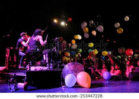 BARCELONA - APR 2: Matt and Kim, energetic indie pop couple surrounded by colorful balloons launched by the audience, performs at Apolo on April 2, 2011 in Barcelona, Spain.