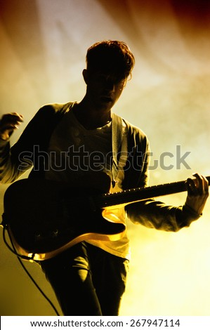 BARCELONA - APR 9: Silhouette of the guitar player of We Are Scientists (band) performs at Jack Daniel's Music Day Festival on April 9, 2011 in Barcelona, Spain. - stock photo