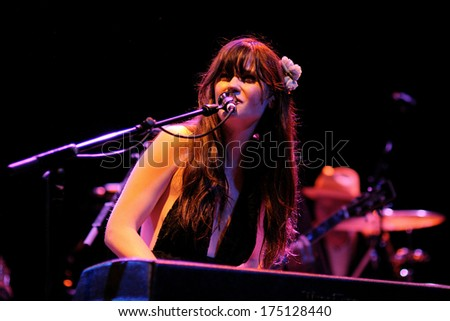BARCELONA - APR 25: Zooey Deschanel, Hollywood Actress and singer, performs with her band She & Him at Apolo on April 25, 2010 in Barcelona, Spain. She perfoms with M. Ward. - stock photo