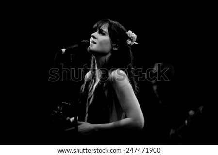 BARCELONA - APR 25: Zooey Deschanel, Hollywood Actress and singer, performs with her band She & Him at Apolo on April 25, 2010 in Barcelona, Spain. - stock photo