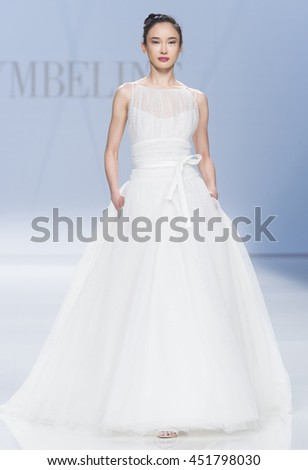 BARCELONA - APRIL 29: a model walks on the Cymbeline bridal collection 2017 catwalk during the Barcelona Bridal Fashion Week runway on April 29, 2016 in Barcelona, Spain.  - stock photo