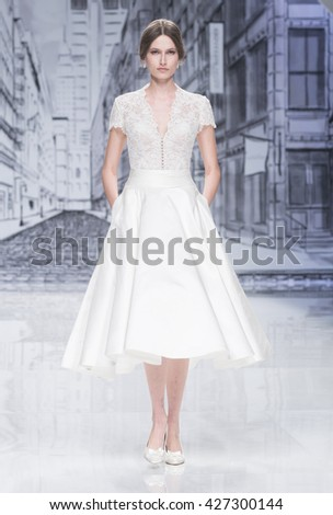 BARCELONA - APRIL 28: a model walks on the Justin Alexander bridal collection 2017 catwalk during the Barcelona Bridal Fashion Week runway on April 28, 2016 in Barcelona, Spain.  - stock photo