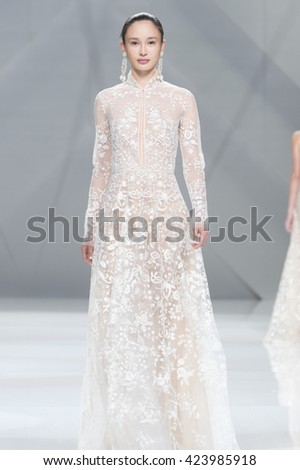 BARCELONA - APRIL 27: a model walks on the Naeem Khan bridal collection 2017 catwalk during the Barcelona Bridal Fashion Week runway on April 27, 2016 in Barcelona, Spain.  - stock photo