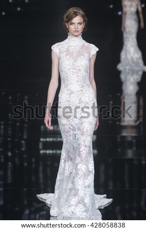 BARCELONA - APRIL 29: a model walks on the Pronovias bridal collection 2017 catwalk during the Barcelona Bridal Fashion Week runway on April 29, 2016 in Barcelona, Spain.  - stock photo