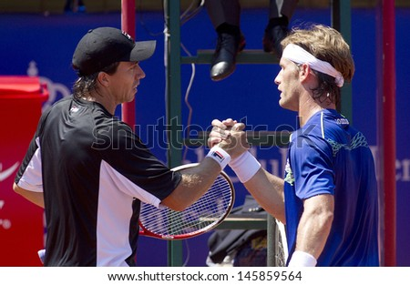 BARCELONA - APRIL, 23: Argentinian Carlos Berlocq and Spanish Gimeno-Traver greet each other after his match against match of Barcelona tennis tournament Conde de Godo on April 23, 2013 in Barcelona - stock photo