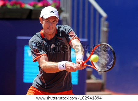 BARCELONA - APRIL, 24: British tennis player Andy Murray in action during his match against Sergiy Stakhovsky  of Barcelona tennis tournament Conde de Godo on April 24, 2012 in Barcelona - stock photo