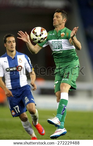 BARCELONA - APRIL, 6: Edu Albacar of Elche CF during a Spanish League match against RCD Espanyol at the Estadi Cornella on April 6, 2015 in Barcelona, Spain - stock photo