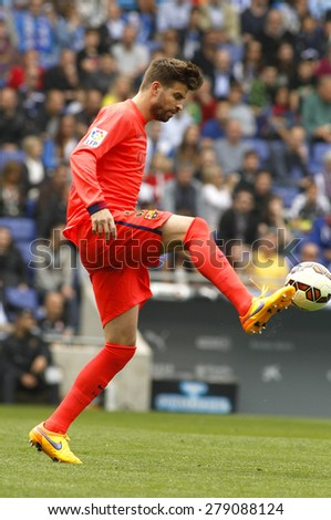 BARCELONA - APRIL, 25: Gerard Pique of FC Barcelona during a Spanish League match against RCD Espanyol at the Power8 stadium on April 25, 2015 in Barcelona, Spain - stock photo