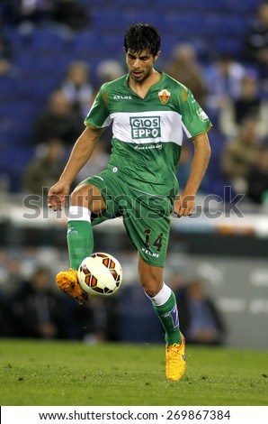 BARCELONA - APRIL, 6: Jose Angel Alonso of Elche CF during a Spanish League match against RCD Espanyol at the Estadi Cornella on April 6, 2015 in Barcelona, Spain - stock photo