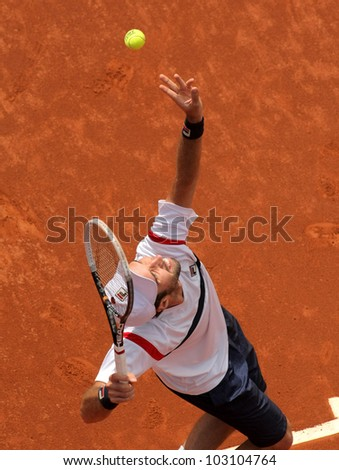 BARCELONA - APRIL, 25: Kazakh tennis player Mikhail Kukushkin in action during his match against Kei Nishikori of Barcelona tennis tournament Conde de Godo on April 25, 2012 in Barcelona - stock photo