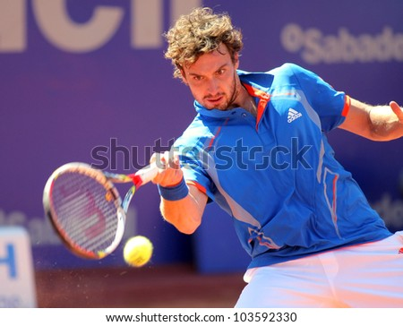 BARCELONA - APRIL, 24: Latvian tennis player Ernests Gulbis in action during his match against Bernard Tomic of Barcelona tennis tournament Conde de Godo on April 24, 2012 in Barcelona - stock photo