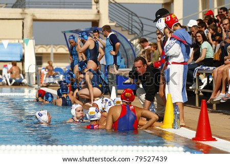 BARCELONA - APRIL 10: Mataro waterpolo players listening the coach instructions during the women Spanish league match CN Mataro - Sant Andreu, final score 4 - 7. April 10, 2011 in Mataro (Spain).