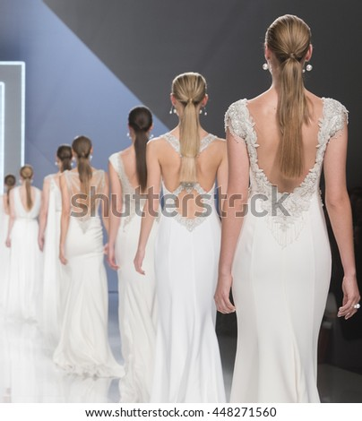 BARCELONA - APRIL 26: models walking on the Rosa Clara bridal collection 2017 catwalk during the Barcelona Bridal Fashion Week runway on April 26, 2016 in Barcelona, Spain.  - stock photo
